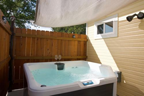 The private hot tub is new and deluxe with a little waterfall