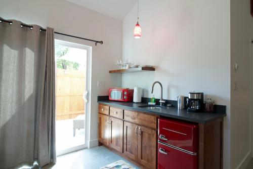 The kitchenette has coffee, tea, microwave and a fridge large enough for wine and more